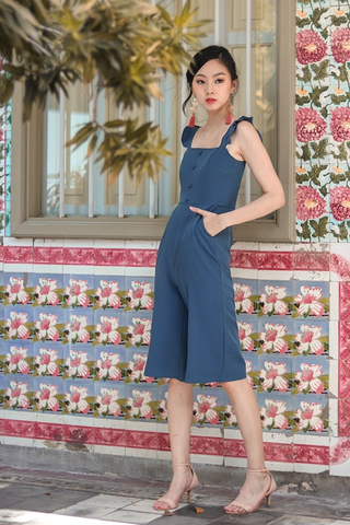 ALEXIS RUFFLES BUTTON JUMPSUIT (ASH BLUE)